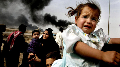 Iraqi families continue to leave Basra in southern Iraq, across one of the town's bridges manned by British soldiers. Iraq warned it would use all means, including suicide attacks, to stop the coalition's advance on Baghdad, as US and British war planes pounded the capital and the southern city of Basra 30 March, 2003 (AFP Photo Pool / Dan Chung)