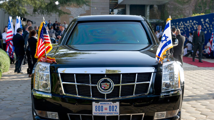 "US President Barack Obama's limousine, known as the ""Beast,"" is seen with American and Israeli flags outside of the President's Residence as Obama meets with Israeli President Shimon Peres in Jerusalem, March 20, 2013.(AFP Photo / Saul Loeb)"