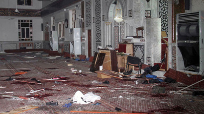 An image made available by the Syrian Arab News Agency (SANA) on March 21, 2013 shows remains and the carpeted floor covered with blood inside of the Iman Mosque in the Mazraa neighbourhood of the Syrian capital Damas, after a suicide attack on March 21, 2013 (AFP Photo / SANA)