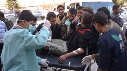 Man is brought to a hospital in the Khan al-Assal region in the northern Aleppo province, as Syria's government accused rebel forces of using chemical weapons for the first time on March 19, 2013 (AFP Photo / SANA)