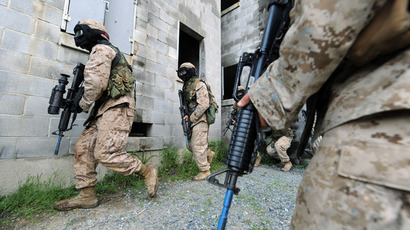 US Marines attack a ''town of insurgents'' during their ''The Making of a Marine - Urban Warfare Training'' at the Marine Corps base in Quantico, Virginia, on June 3, 2009.(AFP Photo / Jewel Samad)
