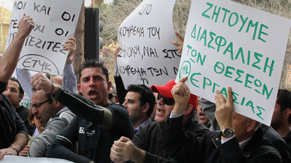 Protesters shout slogans during an anti-bailout rally by employees of Cyprus Popular Bank outside the parliament in Nicosia March 22, 2013.(Reuters / Andreas Manolis)