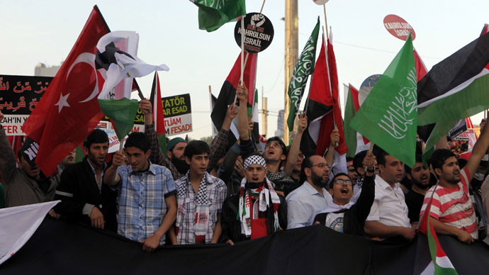 Pro-Palestinian activists attend a rally to mark the second anniversary of the Mavi Marmara Gaza flotilla incident in central Istanbul May 31, 2012. (Reuters/Osman Orsal)
