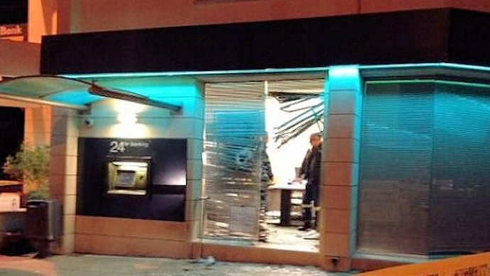 Small blast hits ATM in Cyprus ahead of bailout deal