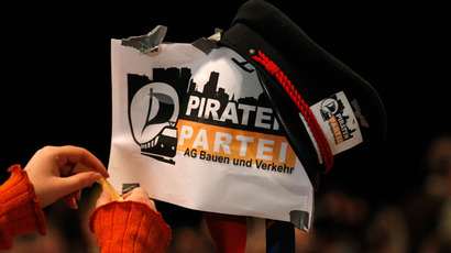 A delegate installs a sign during a party meeting of the Pirate Party (Piraten Partei) in Bochum November 24, 2012.(Reuters / Ina Fassbender)