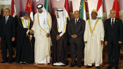 From Left to Right: Lebanese President Michel Sleiman (R), Ikililou Dhoinine, President of the Union of the Comoros, Yemeni President Abdrabuh Mansur Hadi (3rd R), Saudi Crown Prince Salman bin Abdul Aziz al-Saud (C), Tamim bin Hamad al-Thani, the Crown Prince of Qatar, Omani Deputy Prime Minister Fahd bin Mahmud al-Said (2nd L), and Iraqi Deputy President Khudair al-Khuzai (L) pose for a group photograph during the opening of the Arab League summit in the Qatari capital Doha on March 26, 2013. (AFP Photo)