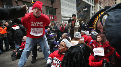 Demonstrators are arrested while protesting school closings on March 27, 2013 in Chicago, Illinois. About 50 people were cited and released after refusing to move from a street during a show of civil disobedience. (Scott Olson/Getty Images/AFP)