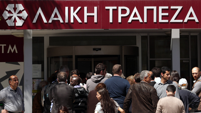 People queue up outside a Laiki bank branch in the Cypriot capital, Nicosia, on March 28, 2013, as they wait for the bank to open after an unprecedented 12-day lockdown (AFP Photo / Patrick Baz)