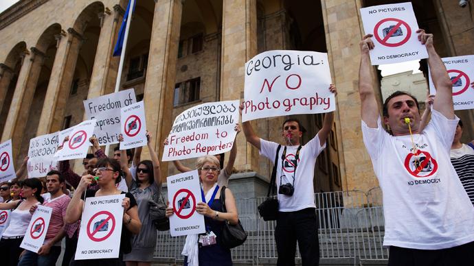 Georgia lifts photographers' Saakashvili-era espionage sentence