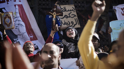 Egyptian political activists, victims and prisoners' relatives shout slogans during a protest against current prosecutor general Talaat Abdallah outside Cairo High Court on March 29, 2013 in Egypt.(AFP Photo / Gianluigi Guercia)