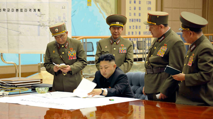 North Korean leader Kim Jong-un (C) presides over an urgent operation meeting on the Korean People's Army Strategic Rocket Force's performance of duty for firepower strike at the Supreme Command in Pyongyang, early March 29, 2013. (Reuters / KCNA)