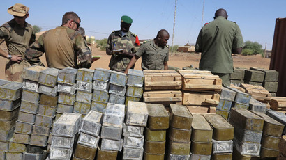Soldiers stand next to cases of ammunition and military equipment on March 30, 2013 in Gao.(AFP Photo / Dorothee Thienot)