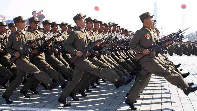 North Korean People's Army soldiers march at the Kim Il Sung square in Pyongyang for the military parade to mark the 60th anniversary of the Workers' Party of Korea, 10 October 2005. Kim Jong Il, general secretary of the Workers' Party of Korea reviewed the military parade. (AFP Photo / KCNA via Korean News Service)