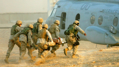 U.S. Marines carry an injured colleague to a helicopter near the city of Falluja, November 10, 2004. (Reuters/Eliana Aponte)
