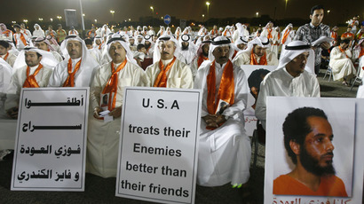 Protesters attend a demonstration outside the US embassy in Kuwait City on May 2, 2012, calling for the release of Kuwaiti prisoners still behind the bars at the US detention camp in Guantanamo Bay.  (AFP Photo)