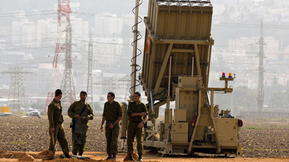 "Israeli soldiers stand next to an ""Iron Dome"" short-range missile defence system near the northern Israeli city of Haifa (AFP Photo / Jack Guez)"
