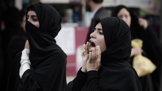Bahrain police break up women's protest with stun grenades