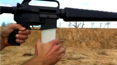 A firearms with a Defense Distributed 3D-printed magazine.