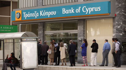 People queue up outside a Bank of Cyprus (BoC) branch in the centre of the capital, Nicosia, on April 2, 2013.(AFP Photo / Patrick Baz)
