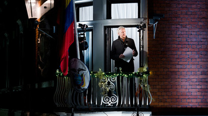 Wikileaks founder Julian Assange addresses members of the media and supporters from the window of the Ecuadorian embassy in Knightsbridge, west London on December 20, 2012.(AFP Photo / Leon Neal)