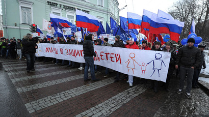 Activists from pro-Kremlin children's advocacy groups march through Moscow on March 2, 2013.(AFP Photo / Alexander Nemenov)