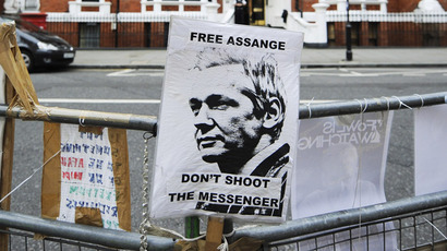 "A sign reading ""Free Assange"" is tied to a barrier across from the Ecuadorian Embassy in London August 14 2012. (Reuters)"