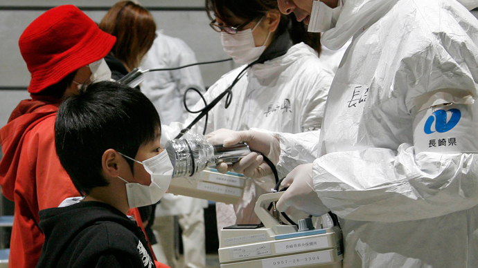 A boy receives a radiation scan at a screening center in Koriyama in Fukushima prefecture (AFP Photo / Go Takayama)