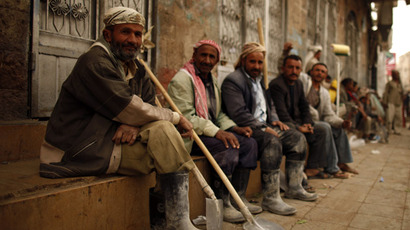 Labourers wait to be hired on a street in Sanaa (Reuters/Khaled Abdullah)