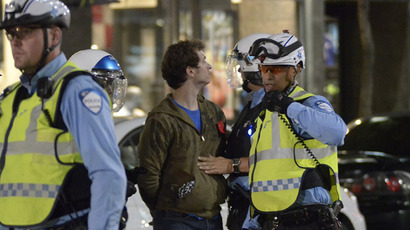 This file photo shows a person being arrested by police during a protest in downtown Montreal. (AFP Photo / Steeve Duguay)