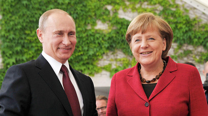 Russian President Vladimir Putin is greeted by German Chancellor Angela Merkel. (RIA Novosti / Alexei Nikolskii)