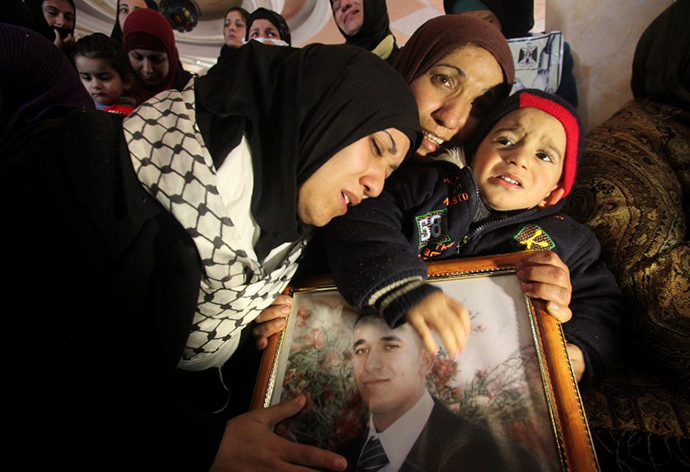 The sisters of Arafat Jaradat (picture), a Palestinian inmate who died in an Israeli prison, mourn their brother's death. (AFP Photo / Hazem Bader)