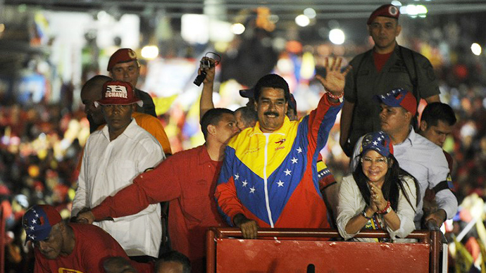 Venezuelan acting President Nicolas Maduro greets supporters during a campaign rally in Puerto Ordaz, Bolivar state, Venezuela on April 6, 2013. (AFP Photo / Juan Barreto)