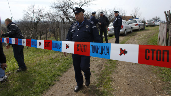 A policeman stands guard in the village of Velika Ivanca, about 40 km (25 miles) southwest of Belgrade April 9, 2013. (Reuters/Marko Djurica)