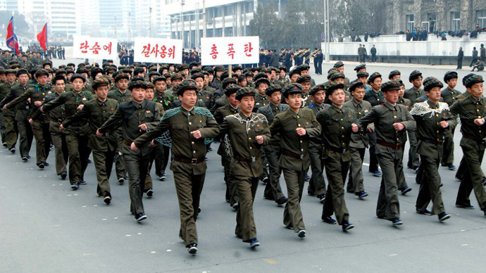 This file picture taken by North Korea's official Korean Central News Agency on March 17, 2013 shows North Korean students singing and marching at the Kim Il-Sung Square in Pyongyang. (AFP Photo / KCNA)