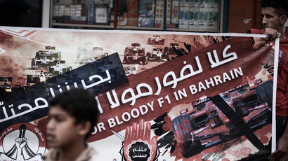 A Bahraini protestor holds a banner against the upcoming Bahrain Formula One Grand Prix during an anti-regime rally in solidarity with jailed political activists and against the race in the village of Al-Malkiya, south of Manama, on April 6, 2013 (AFP Photo / Mohammed Al-Shaikh)