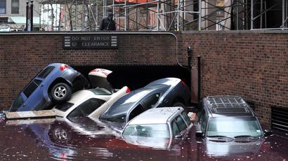 Cars piled on top of each other at the entrance to a garage on South Willliam Street in Lower Manhattan October 31, 2012 in New York.(AFP Photo / Stan Honda)