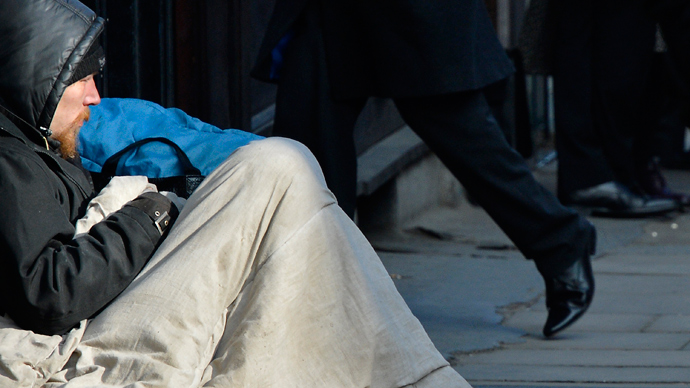 A homeless man sits on a pavement in central London  (Reuters / Toby Melville)