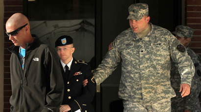 U.S. Army Pfc. Bradley Manning (C) is escorted away after a hearing on the witness list of a speedy trial motion October 17, 2012 at Fort Meade in Maryland. Manning is charged with aiding the enemy and transmitting defense records, plus other counts, after he was accused of passing classified documents to the whistleblower website WikiLeaks.(AFP Photo / Alex Wong)