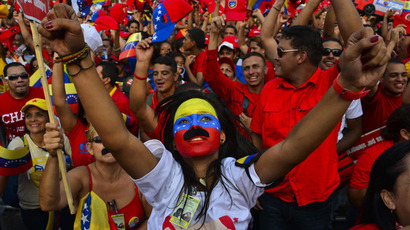 Supporters of Venezuelan acting President and presidential candidate Nicolas Maduro cheer during his closing campaign rally in Caracas on April 11, 2013.(AFP Photo / Luis Acosta)