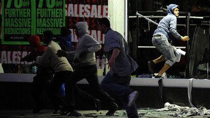Looters run from a clothing store in Peckham, London August 8, 2011. (Reuters / Dylan Martinez)