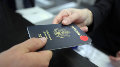 A passenger showing a U.S. passport at the check-in counter of the Sochi airport (RIA Novosti / Mikhail Mokrushin)