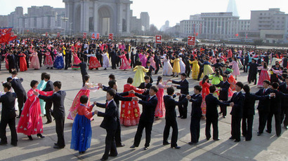 This photo taken on April 11, 2013 and released by North Korea's official Korean Central News Agency (KCNA) early April 12, 2013 shows young residents taking part in a dancing party to mark the first anniversary of Kim Jong-Un's election as first secretary of the Workers' Party of Korea in Pyongyang. (AFP Photo/KCNA via KNS)