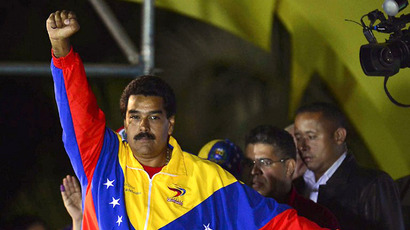 Venezuelan elected President Nicolas Maduro gestures following the election results in Caracas on April 14, 2013. (AFP Photo / Luis Acosta)