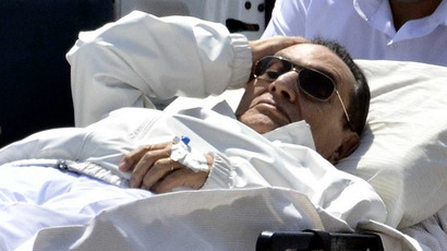 Ousted Egyptian president Hosni Mubarak is wheeled out of an ambulance outside the Maadi military hospital following a hearing in Cairo. (AFP Photo / Mohamed El-Shahed)