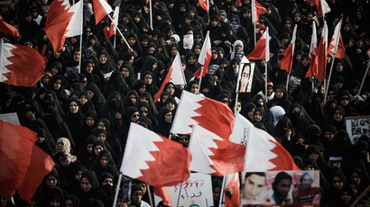 Bahraini women hold up national flags during an anti-regime rally to claim that democracy is their right and to support jailed political activists on April 12, 2013 in the village of A'ali, south of Manama. (AFP Photo / Mohammed Al-Shaikh)