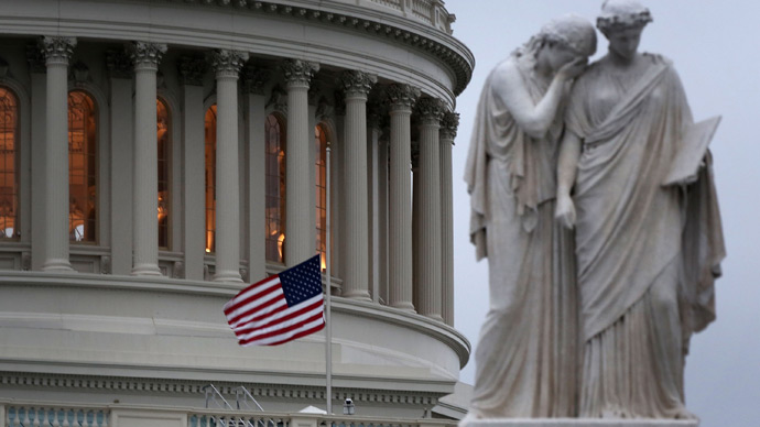 A U.S. flag flies at half staff on the U.S. Capitol April 15, 2013 on Capitol Hill in Washington, DC (AFP Photo / Alex Wong)