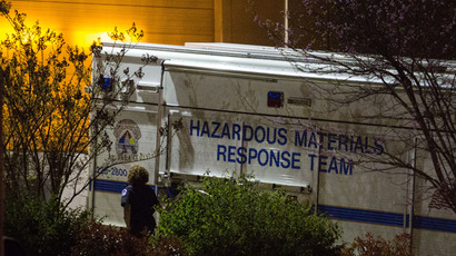 An official walks past a hazardous materials response team truck outside a mail sorting facility April 16, 2013 in Hyattsville, Maryland (AFP Photo / Drew Angerer)