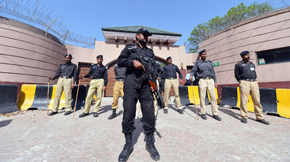Pakistani police stand guard outside the residence of former Pakistani president Pervez Musharraf after a court ordered for his arrest in Islamabad on April 18, 2013. (AFP Photo / Aamir Qureshi)