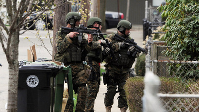 Police conduct a door-to-door search for 19-year-old Boston Marathon bombing suspect Dzhokhar A. Tsarnaev on Francis Street April 19, 2013 in Watertown, Massachusetts. (Darren McCollester/Getty Images/AFP)