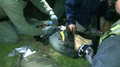 Handcuffed Dzhokhar Tsarnaev being frisked by a law enforcement after he was taken out of his last refuge in a boat before being transported to Mount Auburn Hospital.(Photo from twitter.com user @BMTrader)
